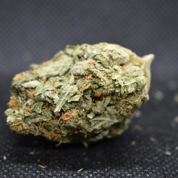 Weed strain nug showing pink kush strain