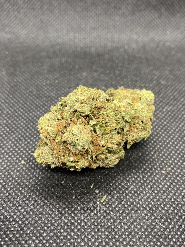 Weed strain nug showing white rhino strain